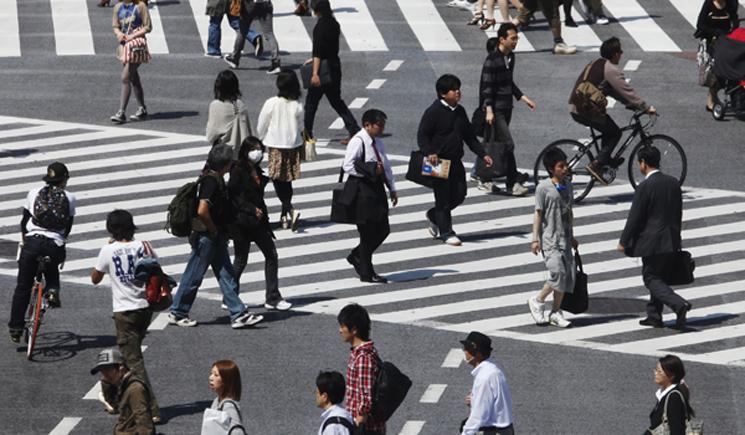 People cross a street in Tokyo